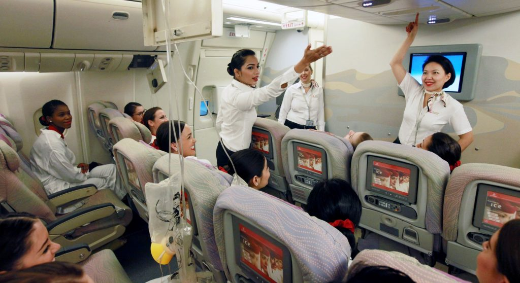 New Emirates Cabin Crew receiving practical SEP training on a mock Boeing 777. Photo Credit: Emirates