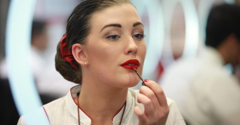 A member of Emirates Cabin Crew learns how to achieve the right look in the I&U class. Photo Credit: Emirates