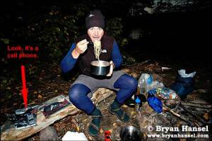 Bryan Hansel eats noodles in the BWCA.