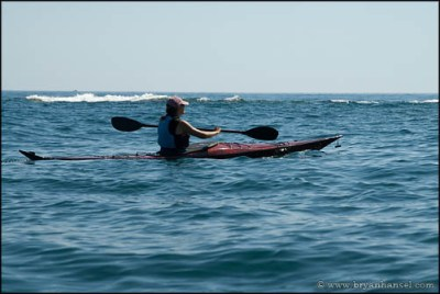 Ilena paddles toward Artist's Point in her new Iggy - a replica of Ken Taylor's Greenland kayak.