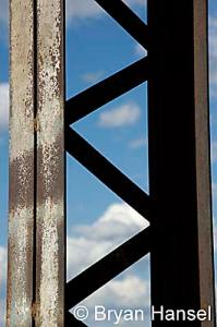 <strong><em>Metal and Clouds</em>. This is a close-up detail picture of an old abandoned bridge on the Iowa River. It is a great shot to show the details in my Hawkeye Wildlife Management Slide show.</strong>