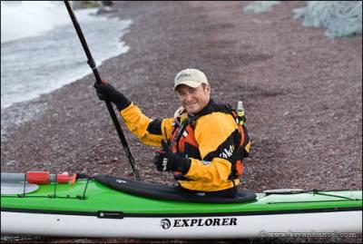 Bryan Hansel prepared to launch his sea kayak.