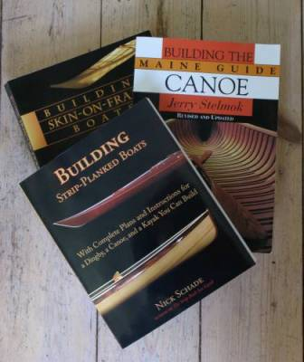 Canoe and kayak building books on the floor.