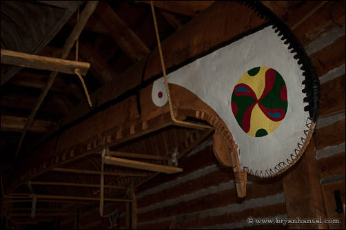 A birchbark canoe hanging in the canoe shed