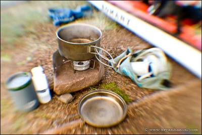 Cooking with a homemade Penny Stove.
