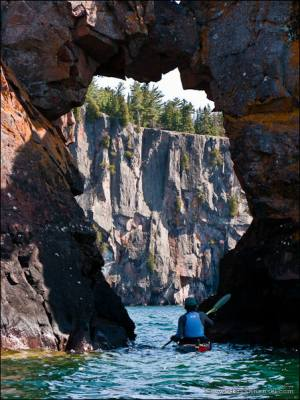 Sea kayaking under the arch at Tettegouche State Park.
