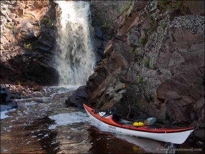 Kayak at the waterfall on the Fall River, Minnesota.