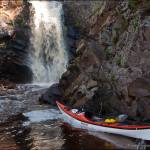 Kayak at the waterfall on the Fall River, Minnesota.