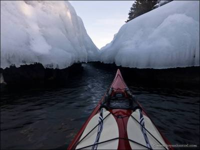 Winter ice and kayaking near it.