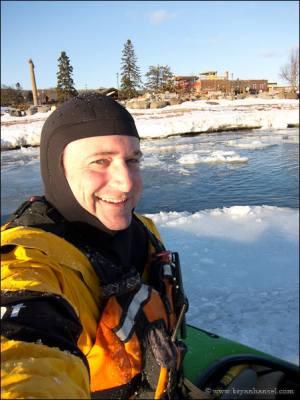 Kayaker sitting on ice cake.