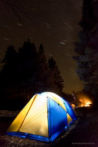 Canoe camping in fall with star trails