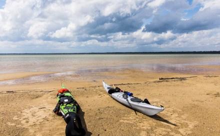 Kayaks on a remote beach.