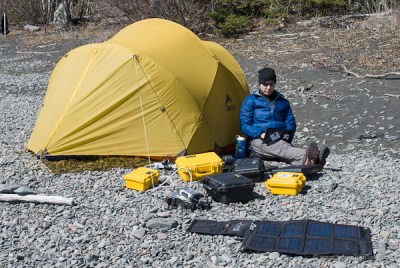 Using a computer on a remote beach during an expedition