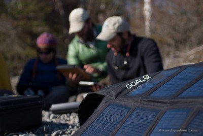 Goal0 solar panels power computers while camping.