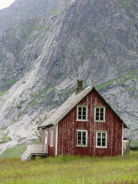 The shape of this simple house seems to flow directly from the cliff face in the background.