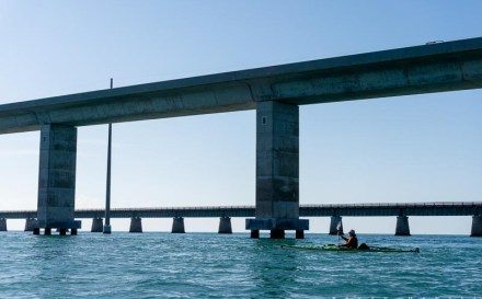 kayak ferrying under the seven mile bridge