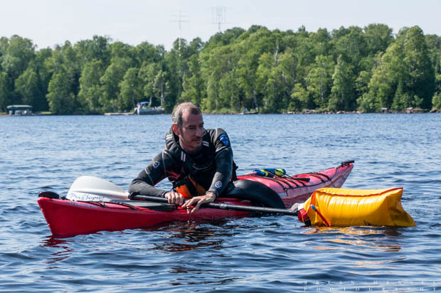 a kayaker doing the paddle float rescue