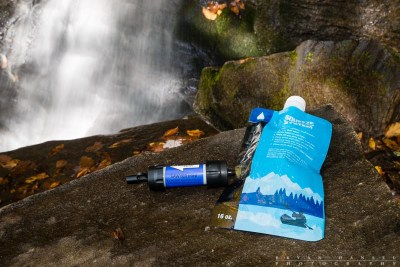 Sawyer Mini filter sits in front of a waterfall