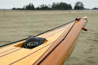 compass in wooden kayak