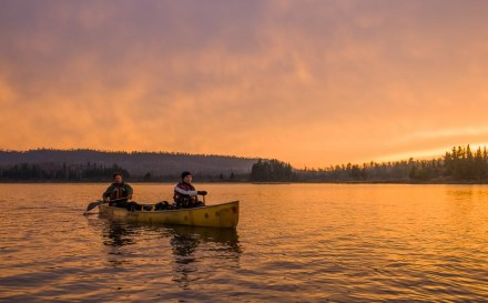 The sunsets just as we arrive at our campsite on South Fowl Lake. Paddlers Amy and Dave Freeman.