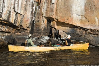 Amy and Dave Freeman next to pictographs on Lac la Croix. in the BWCA, Minnesota.