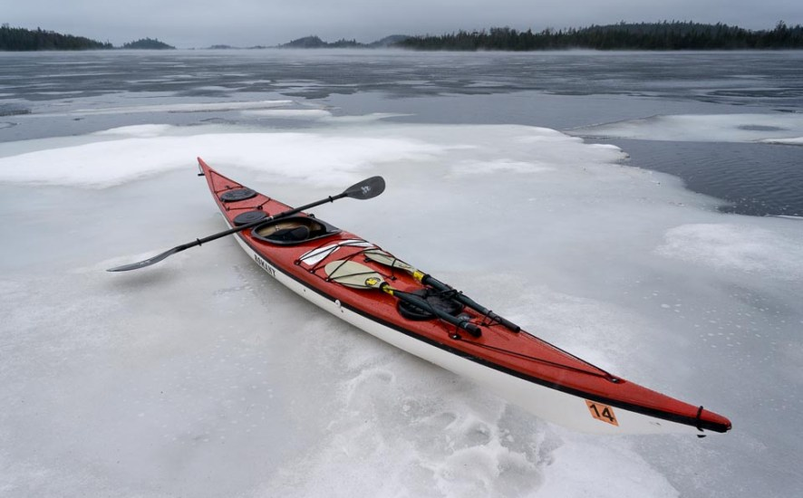 sea kayak on ice in cold water