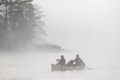 Dave and Amy Freeman paddling canoes in the BWCA