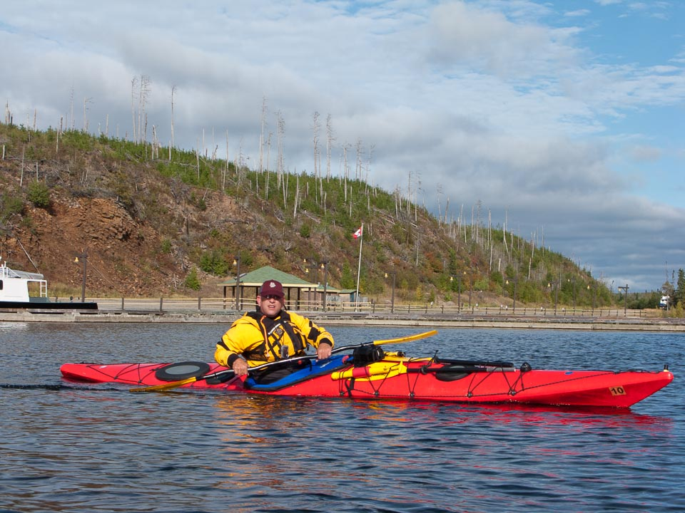 Timothy Russell paddles his kayak away from the harbor.