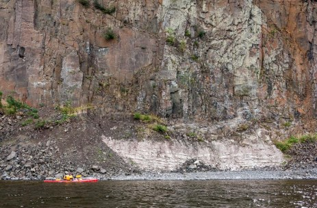 Timothy Russell paddles past Pipestone Point on Lake Nipigon, ON.