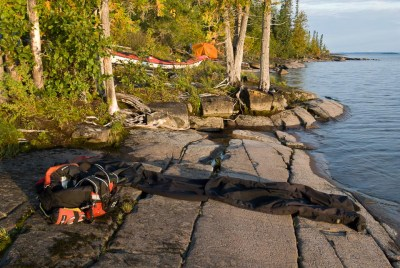 Drying out paddling clothing in the morning sun on Lake Nipigon.