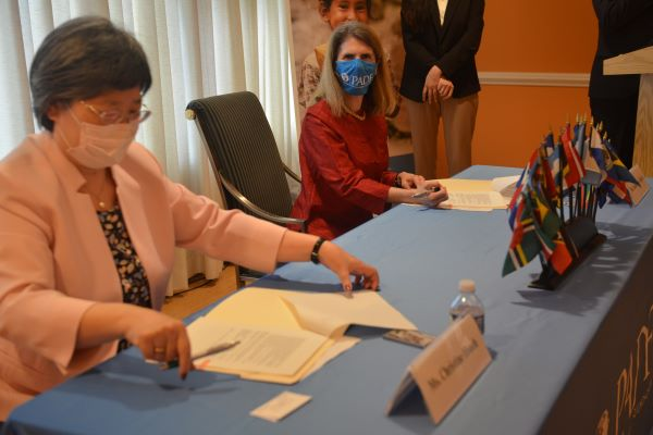 Taylor and M. Y. Hsueh sign the Memorandum of Understanding to strengthen disaster management capabilities in Guatemala and Paraguay.