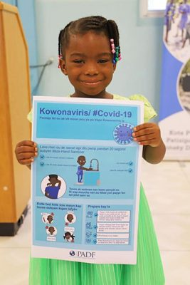 Our awareness campaign on COVID-19 prevention in Haiti includes the distribution of user-friendly educational materials.