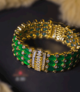 Green colour bracelet design in american diamonds