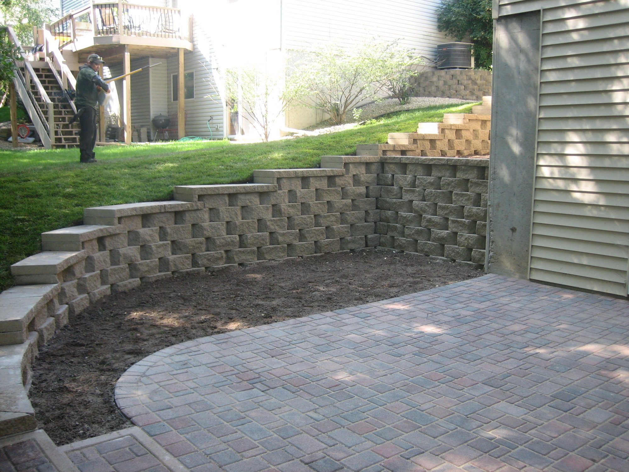 Retaining Wall with Caps and a Paver Patio installed in ... on Patio Stone Wall Ideas  id=43303