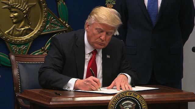 Trump-signs-immigration-ban_1485627817583_187390_ver1_20170128182929-159532