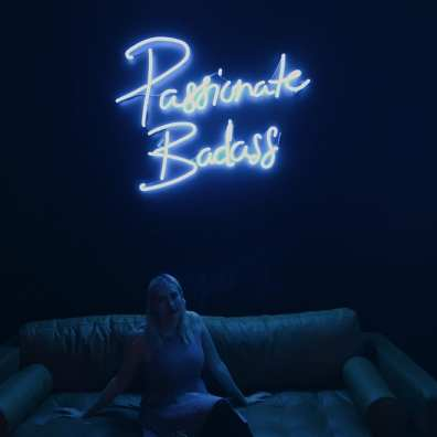 Passionate Badass neon sign - Paige at SheDoesTheCity 10 year event