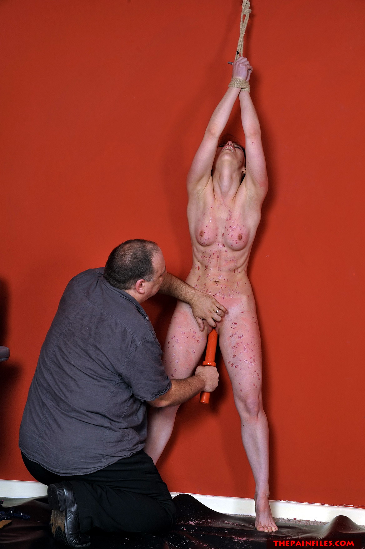 Poor slave punished with hot wax and hard spanking