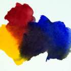 Mixing a Blue, Red and Yellow will give you a dull grey to black color depending on proportions of each color mixed
