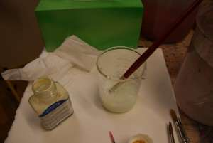 Dip brush in soapy water before dipping into art masking fluid
