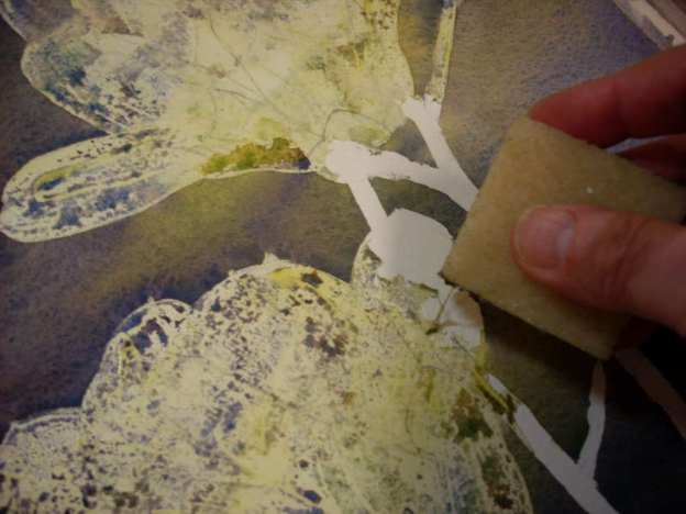 After the watercolor wash is totally dry you can remove the dry art masking fluid with a crepe eraser