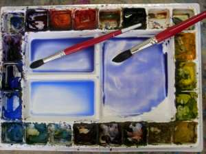 Initial color mix for sunset sky over beach watercolor painting