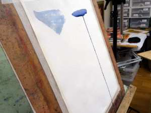 At a step angle a wet watercolour wash will drip but a not so wet one will not.