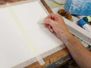 Image showing me drawing with a candle where the highlights in my watercolor painting are to be preserved