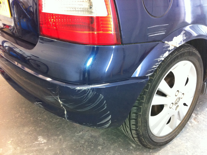 Damaged bumper before Paintmedic repair