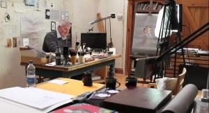 Chris Riddell Children's Laureate illustrator workng in his studio