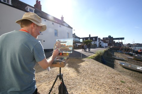 Artist Tony Robinson painting Wells Granary from the Quayside, Norfolk