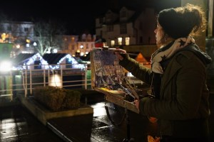 Artist Sarah Allbrook painting the Market at Paint Out Norwich Winter Nocturne