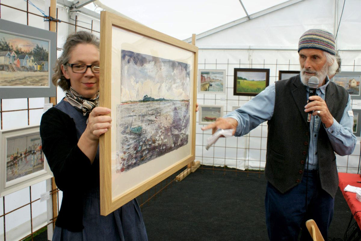 Judges Nicholas Barnham and Amanda Geitner revealing First Prize at Paint Out Wells 2016 Alfie Carpenter Hoping for Sun photo by Katy Jon Went