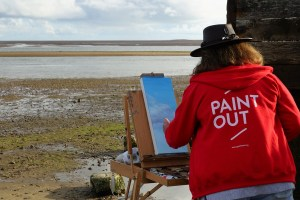 Artist Wendy Kimberley painting at Paint Out Wells beach sunrise. Photo by Katy Jon Went