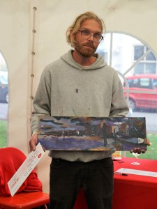 Artist Jack Godfrey wins First prize at Paint Out Wells 2017. Photo by Katy Jon Went